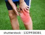 sports person injured leg | Shutterstock . vector #1329938381