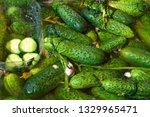 green fresh pickled cucumbers... | Shutterstock . vector #1329965471