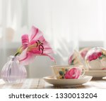 the tea cup is decorated with... | Shutterstock . vector #1330013204