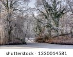 frozen pond and trees covered... | Shutterstock . vector #1330014581