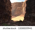 A view of a canyon in the desrt with a person