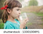 child glass of water. selective ... | Shutterstock . vector #1330100891