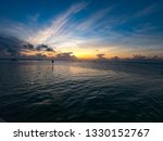 sunset on the island of caye... | Shutterstock . vector #1330152767