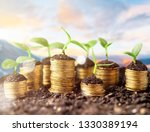 coins in soil with young plants ...   Shutterstock . vector #1330389194