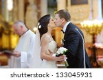 Bride And Groom Kissing In A...