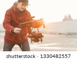 cameraman with a stabilizer in... | Shutterstock . vector #1330482557
