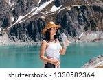 beautiful youg woman drinkig...   Shutterstock . vector #1330582364