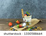 bowl of homemade granola with... | Shutterstock . vector #1330588664