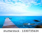 the wooden bridge stretches... | Shutterstock . vector #1330735634