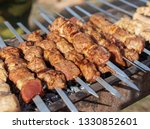 shish kebab on skewers is fried ... | Shutterstock . vector #1330852601