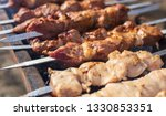 shish kebab on skewers is fried ... | Shutterstock . vector #1330853351