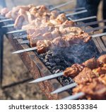 shish kebab on skewers is fried ... | Shutterstock . vector #1330853384