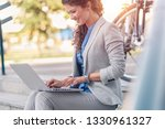 young businesswoman sitting on... | Shutterstock . vector #1330961327