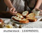 woman spreading tasty garlic...   Shutterstock . vector #1330985051