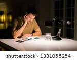 young handsome man studying at... | Shutterstock . vector #1331055254