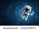 astronaut in outer space.... | Shutterstock . vector #1331229971