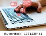 man is using laptop with black...   Shutterstock . vector #1331235461