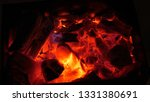 red fire burns wood in dark ... | Shutterstock . vector #1331380691