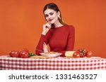 woman in the kitchen at the...   Shutterstock . vector #1331463527