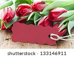 red tulips and tag with copy space - stock photo