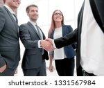 business shaking hands in the... | Shutterstock . vector #1331567984