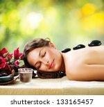 spa stone massage. beautiful... | Shutterstock . vector #133165457