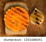 grilled pumpkin slices with... | Shutterstock . vector #1331688341