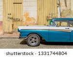 old 1950's chevrolet car parked ... | Shutterstock . vector #1331744804