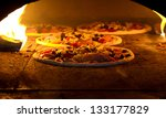 pizza cooking in a tradition... | Shutterstock . vector #133177829