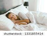 girl well sleeping on bed in... | Shutterstock . vector #1331855414