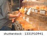 man is in the bakery department ... | Shutterstock . vector #1331910941