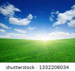green meadow under blue sky...   Shutterstock . vector #1332208034