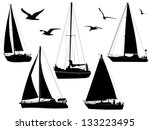 Sail Boats In Silhouettes With...