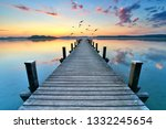 old wooden jetty in the morning ... | Shutterstock . vector #1332245654