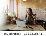 woman working on her laptop at... | Shutterstock . vector #1332315641
