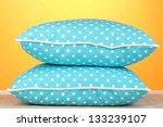 blue bright pillows on orange... | Shutterstock . vector #133239107