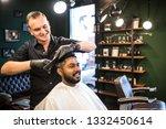 handsome bearded man is looking ... | Shutterstock . vector #1332450614