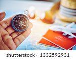 tourists hold a compass and... | Shutterstock . vector #1332592931