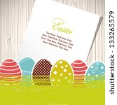 Easter eggs with grass and paper - stock vector