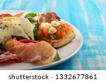 fresh appetisers table with... | Shutterstock . vector #1332677861