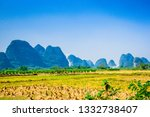rice field with mountain... | Shutterstock . vector #1332738407
