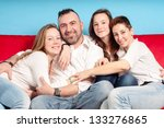 happy family on the couch in... | Shutterstock . vector #133276865