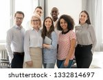 happy multicultural work team... | Shutterstock . vector #1332814697
