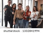 five young people shows thumbs... | Shutterstock . vector #1332841994