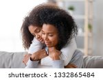 family sitting on couch in... | Shutterstock . vector #1332865484