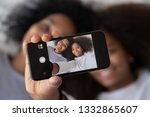 african kid lying with mother... | Shutterstock . vector #1332865607