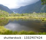 peters pool franz josef glacier ... | Shutterstock . vector #1332907424