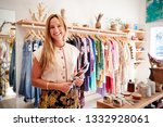 portrait of female owner of... | Shutterstock . vector #1332928061