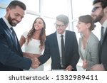 close up. handshake business... | Shutterstock . vector #1332989411