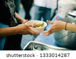 food from the rich gives to the ... | Shutterstock . vector #1333014287